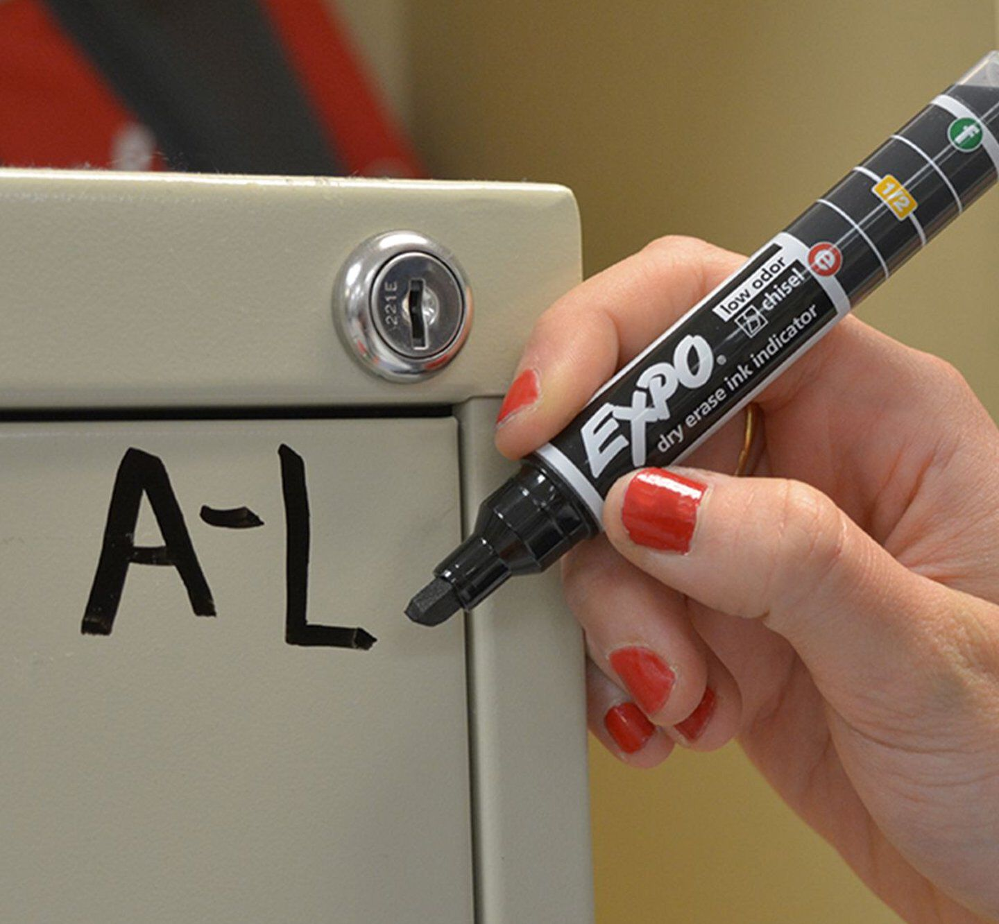 Labeling file cabinet with Expo marker