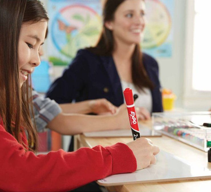 Writing with Expo marker in classroom