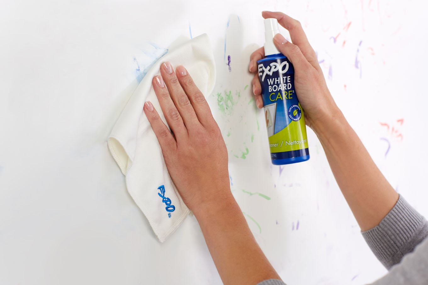 spray-cleaner-and-towel-used-to-erase-whiteboard.jpg