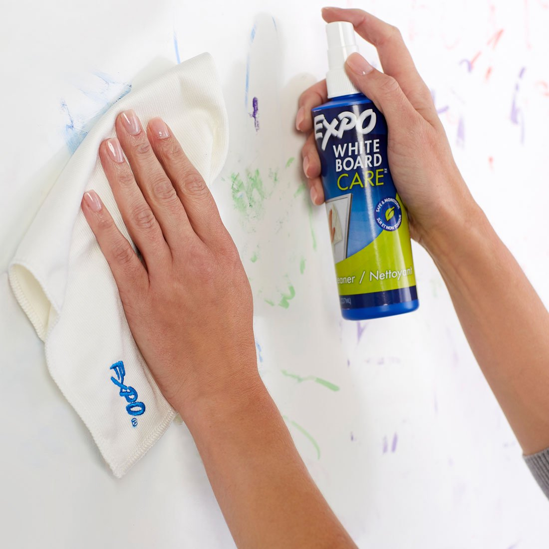 using-spray-and-cloth-on-whiteboard-to-remove-marker.jpg