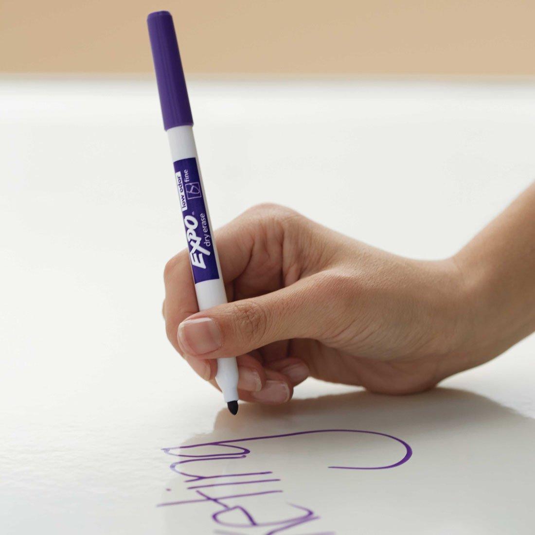 writing on whiteboard in fine purple marker