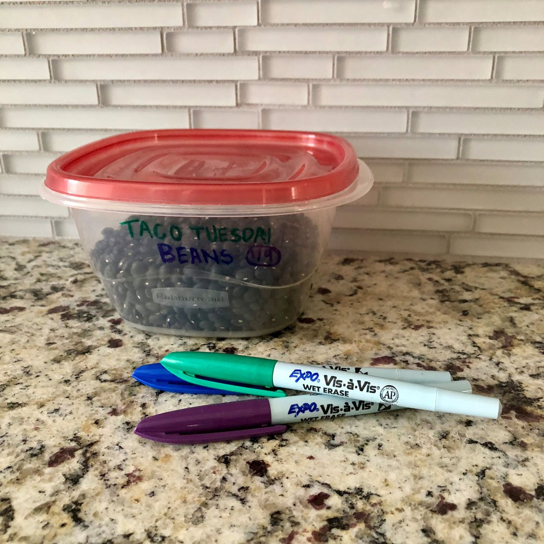 labeled-leftovers-container-on-counter-with-expo-vis-a-vis-markers.jpg