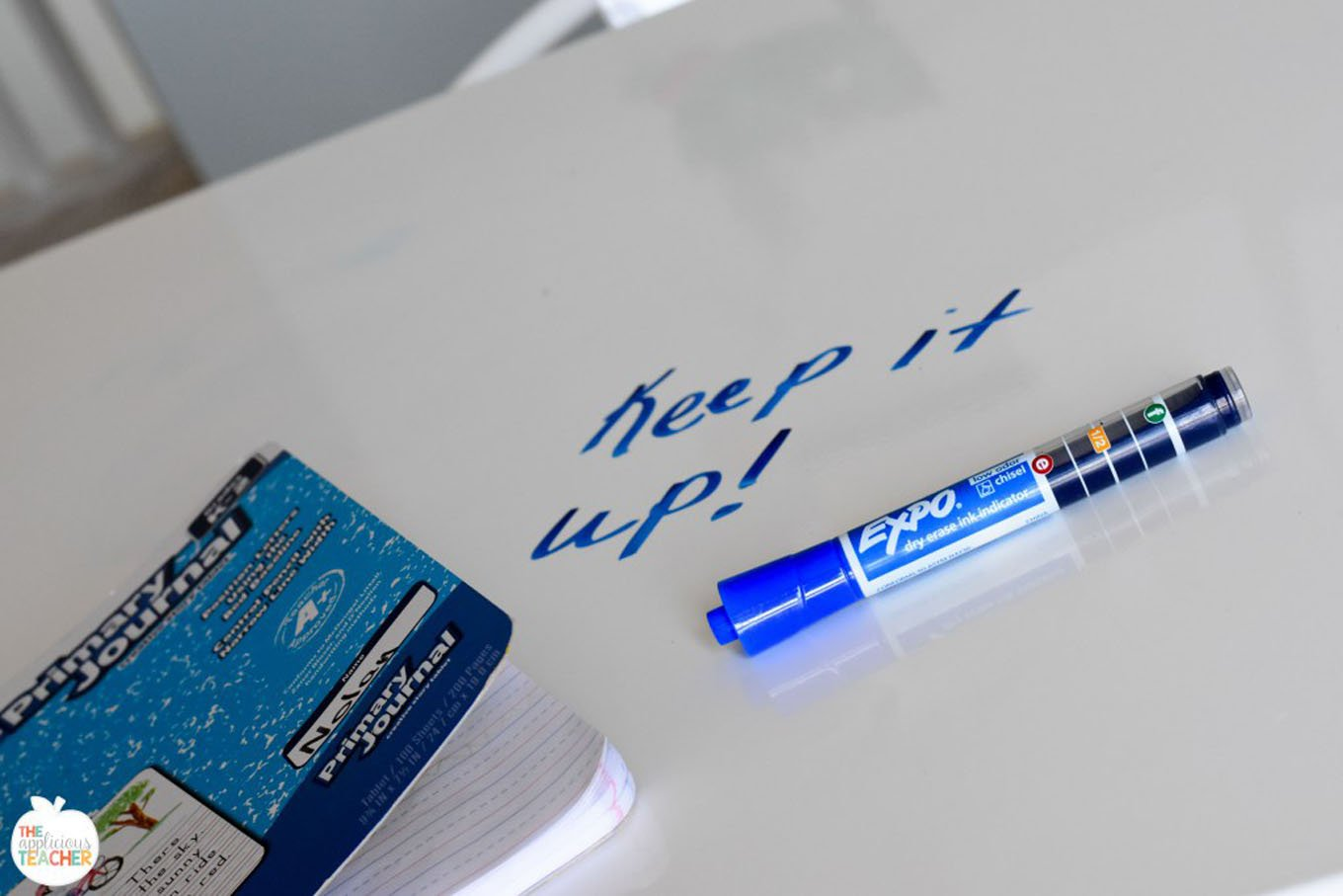 motivational-message-written-on-table-in-blue-expo-marker.jpg