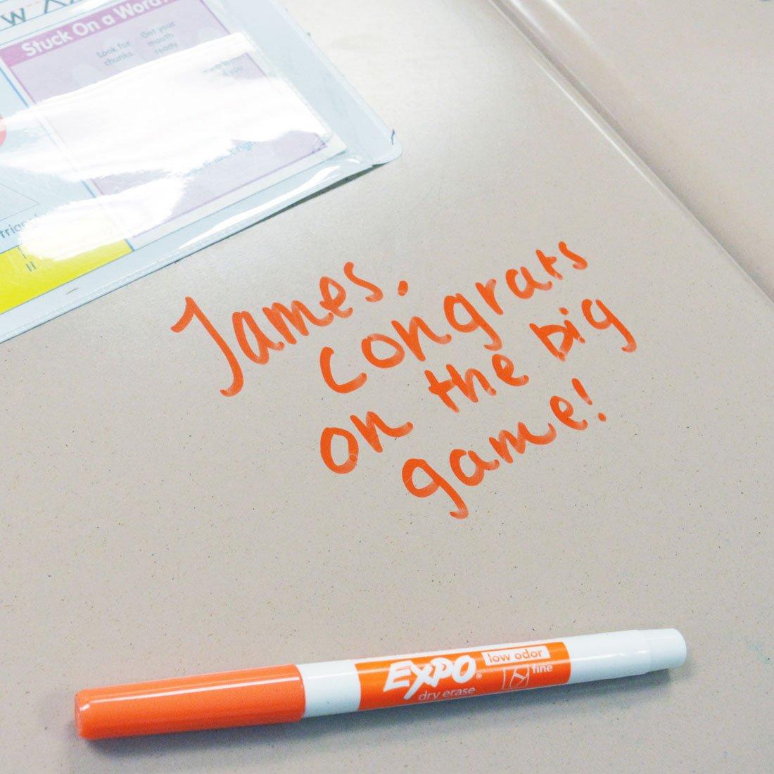 congrats-message-written-on-desk-in-orange-fine-expo.jpg
