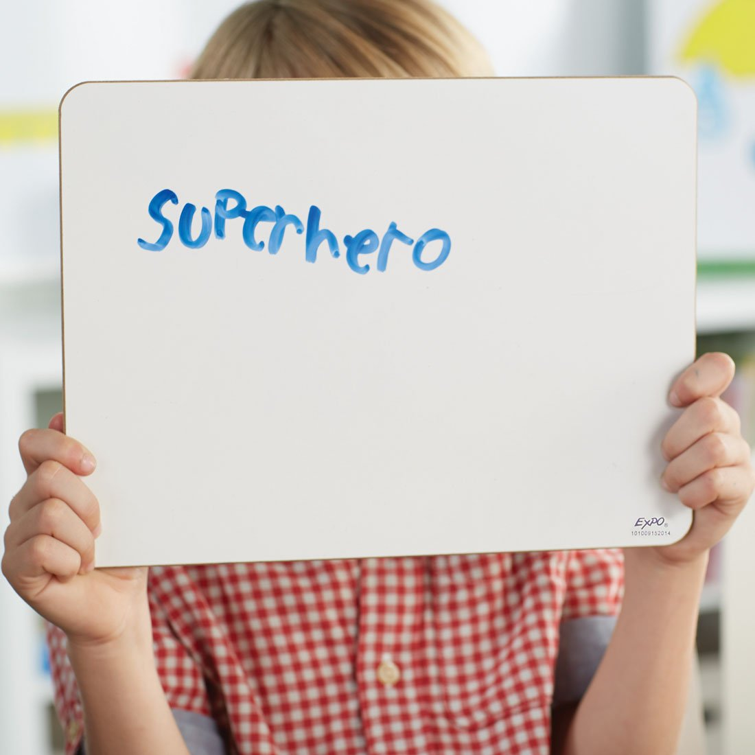 student-holding-up-individual-whiteboard-with-superhero-written-on-it.jpg