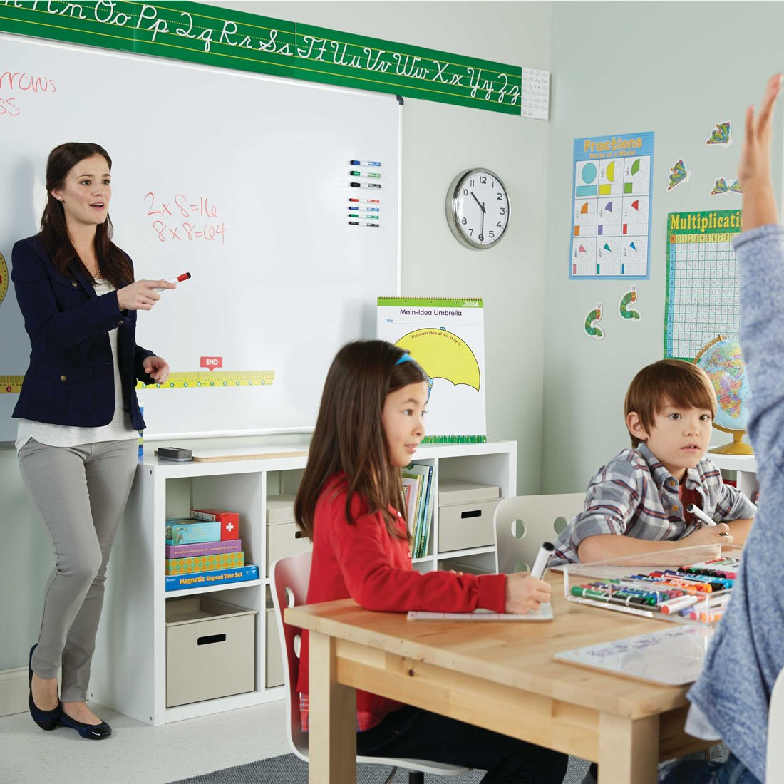 teacher-in-front-of-class-at-board-with-expo-marker