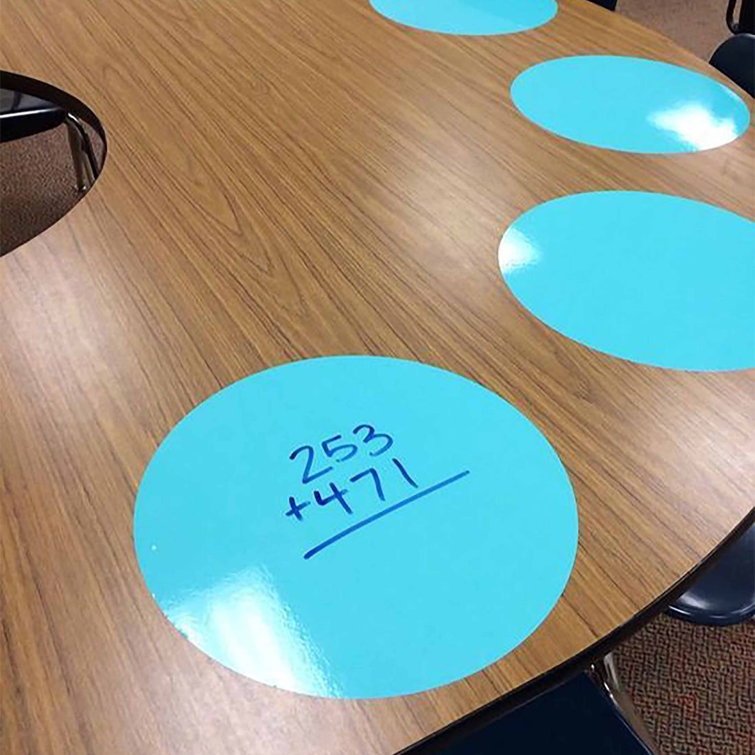 math-problems-written-on-blue-place-mats-on-table.jpg