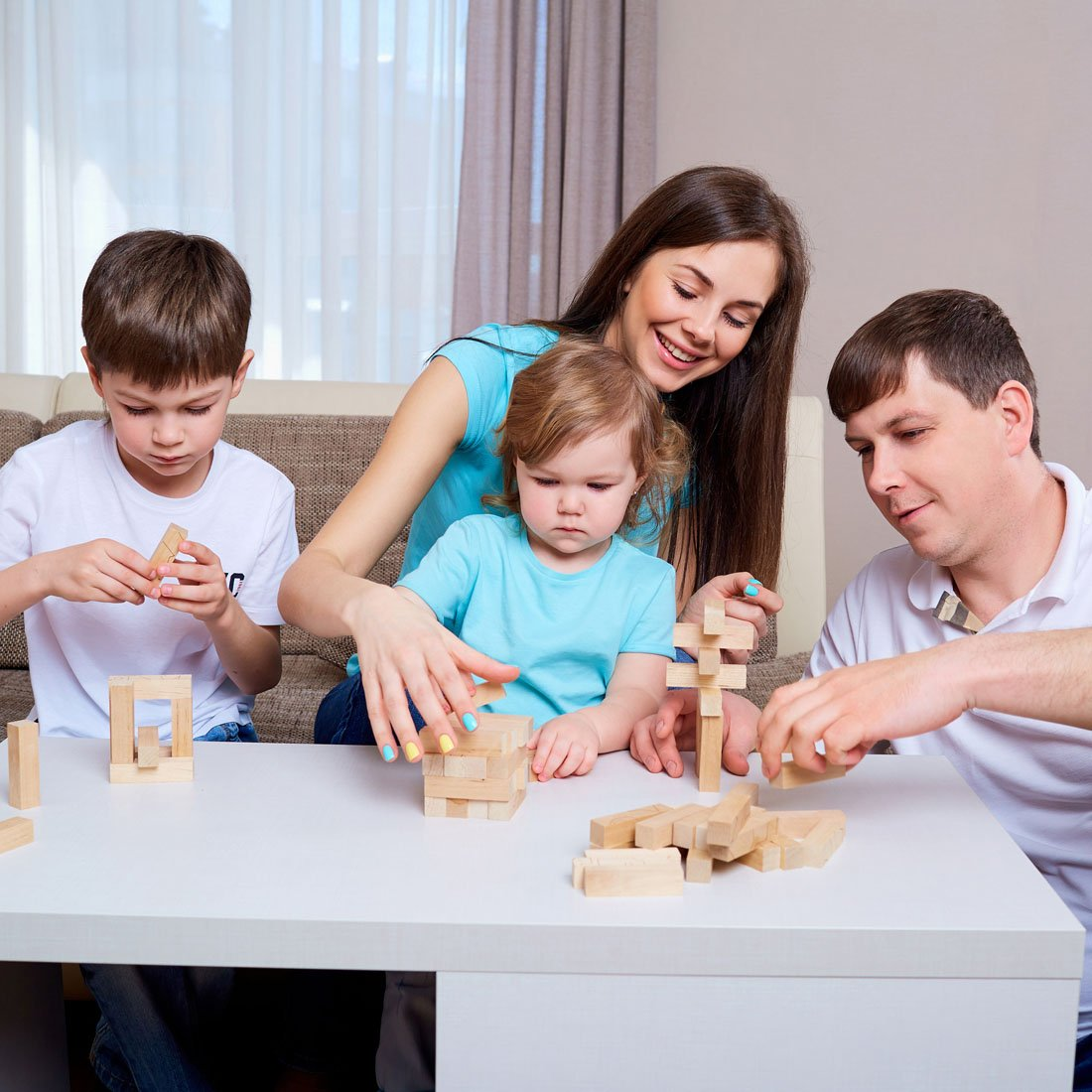 family-playing-building-with-blocks-on-table.jpg