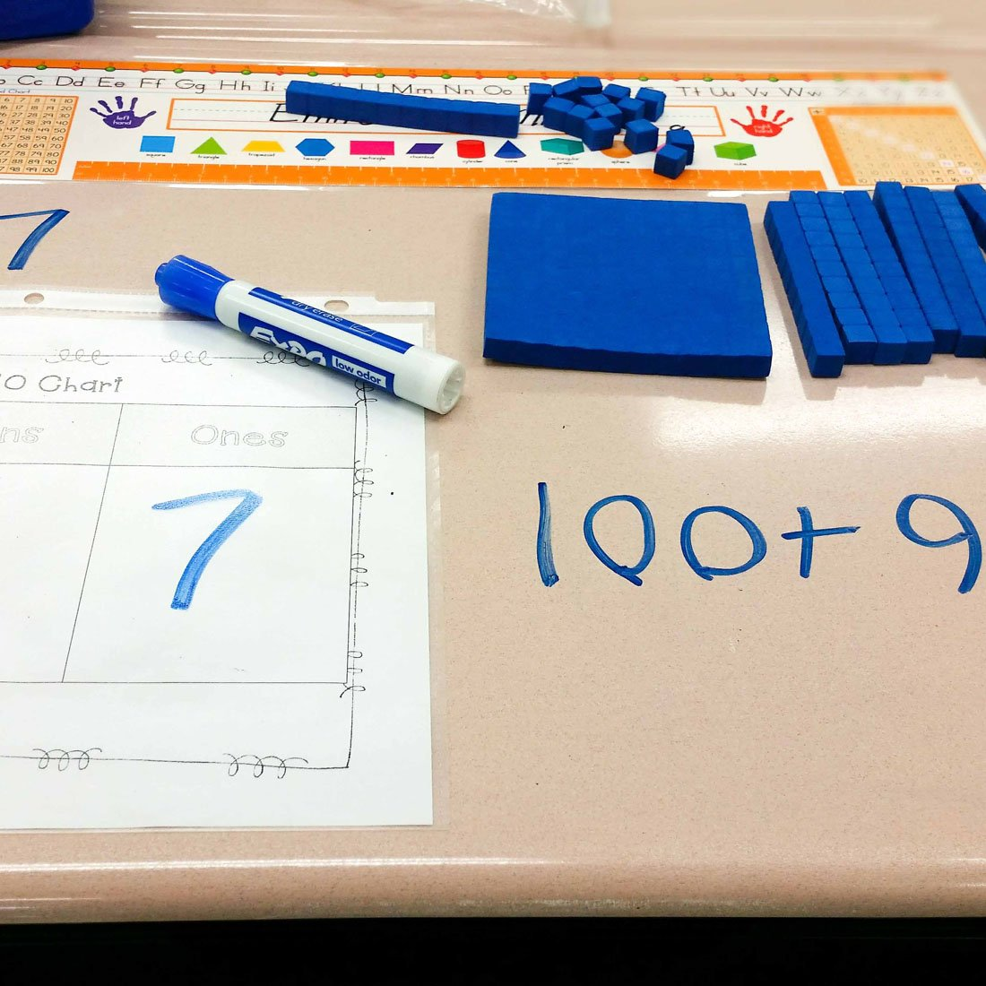 writing-math-problems-on-desk-with-expo-chisel-marker